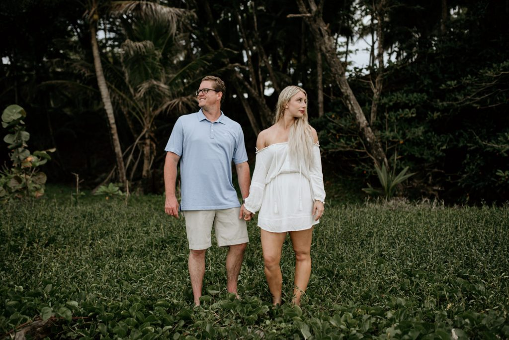 couple holding hands in the jungle on little corn island