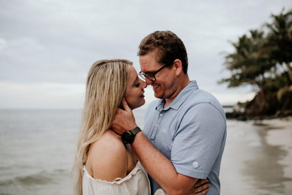 couple embracing on a beach on little corn island